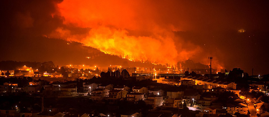 Wildfires kill dozens as they spread across Portugal and Spain