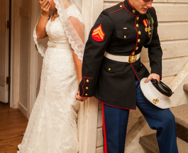 'I prayed to God for my beautiful wife': Marine and his bride share the story behind their touching wedding picture.